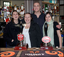 Staff behind bar