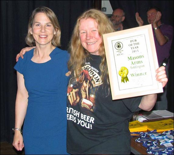 Dr Tania Mathias MP presents the award for Richmond and Hounslow Camra Pub of the Year 2015 to Rae Williams, landlady of the Masons Arms.